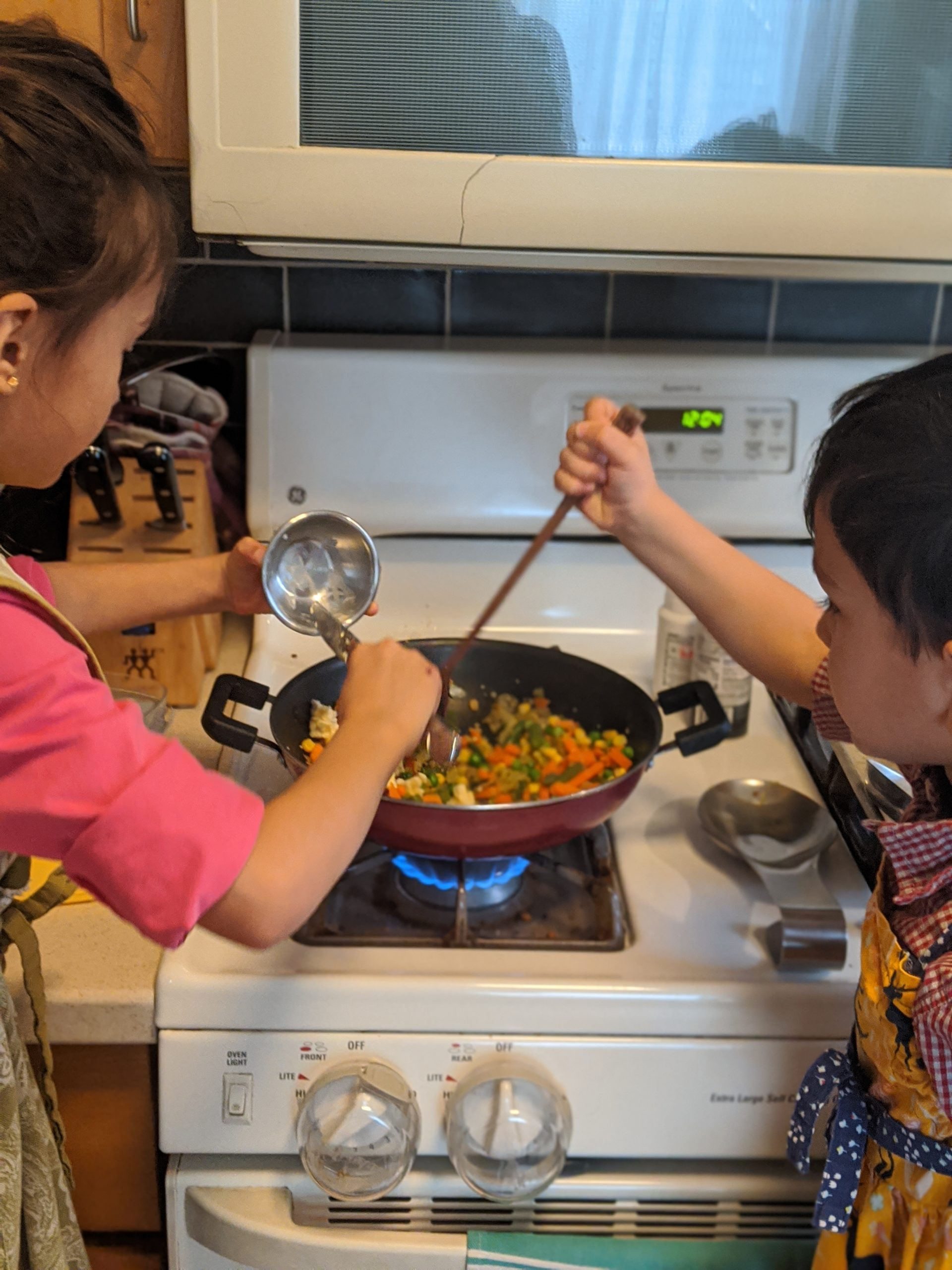 Children cooking on the stove