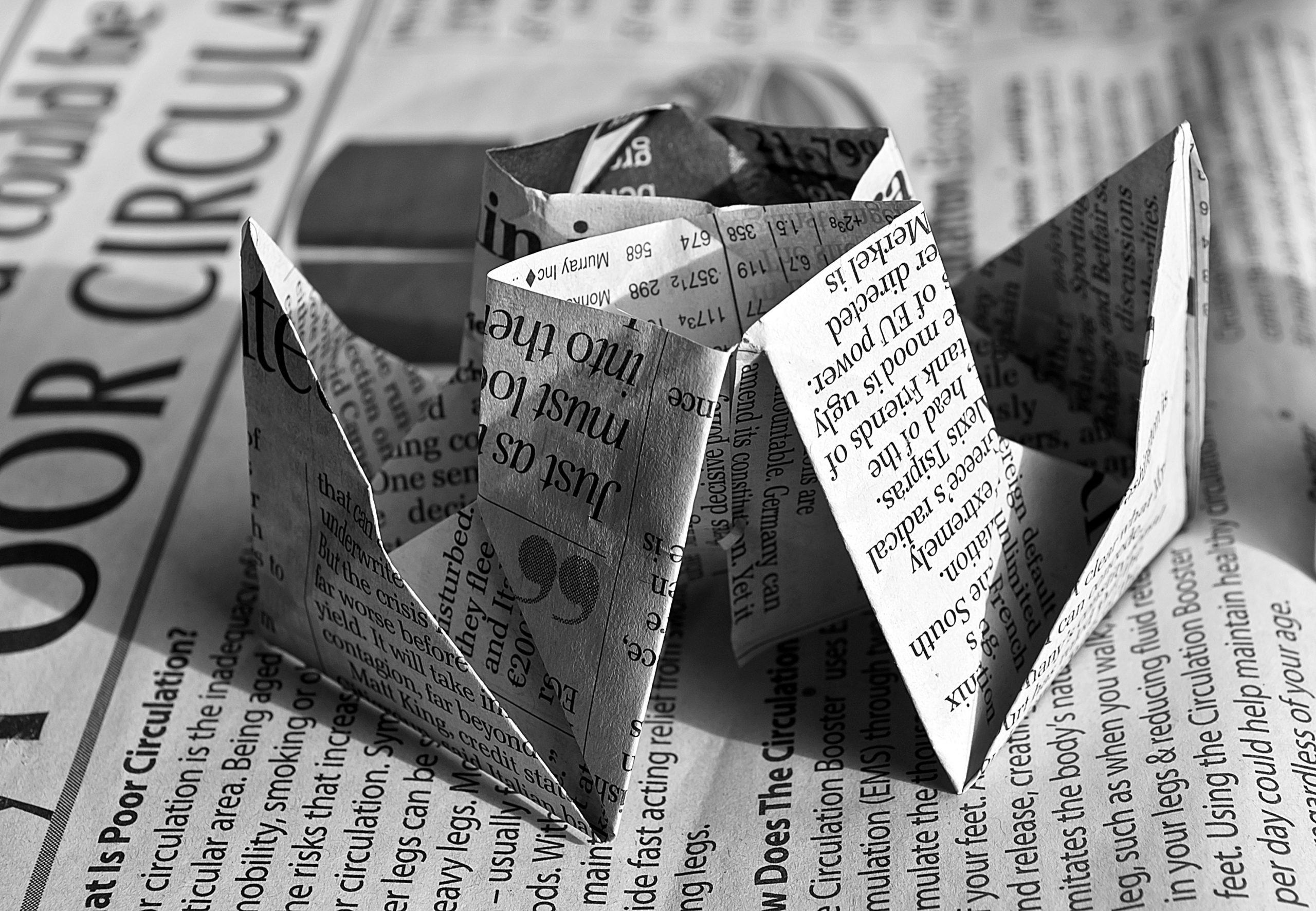 Newspaper folded in an origami fashion